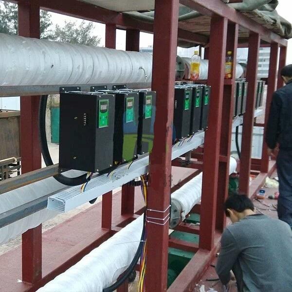 máy nhựa lắp gia nhiệt điện từ, gia nhiệt nước dùng công nghệ gia nhiệt từ